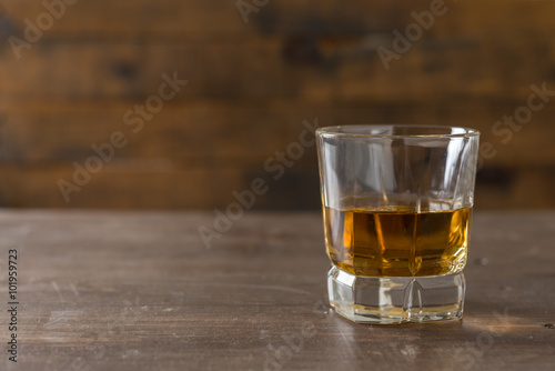 Foto op Canvas Alcohol Whiskey in a glass
