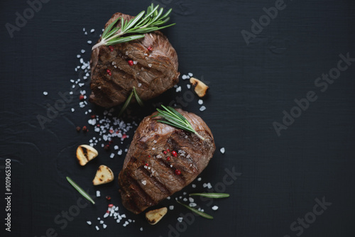Above view of two grilled filet mignon beefsteaks, closeup Canvas Print