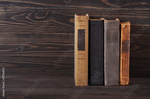Valokuva  group of old hardcover books on a dark wooden background