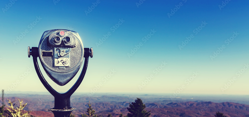 Fototapety, obrazy: Coin-operated binoculars looking out over a mountain landscape