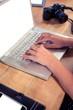 Businesswoman typing on laptop keyboard