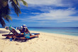 Two chairs on tropical beach vacation