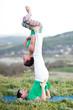 Acroyoga - Balancing on Feet. Couple practicing acroyoga in mountains at sunrise. Crimea