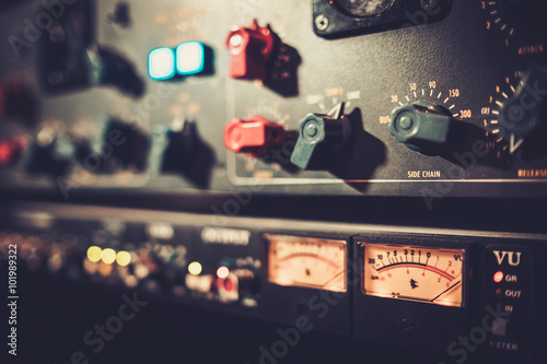 Close-up amplifier equipment with sliders and knobs at boutique Canvas Print