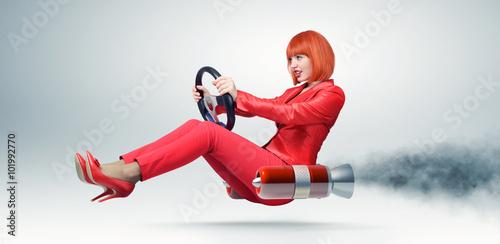 Fotografie, Obraz  Mladá elegantní žena v červeném autě řidiče s volantem, auto koncept