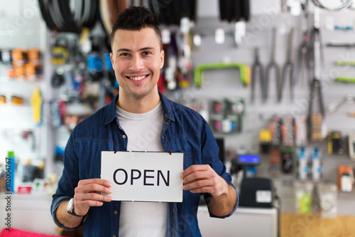 Poster Positive Typography Bike shop owner holding open sign