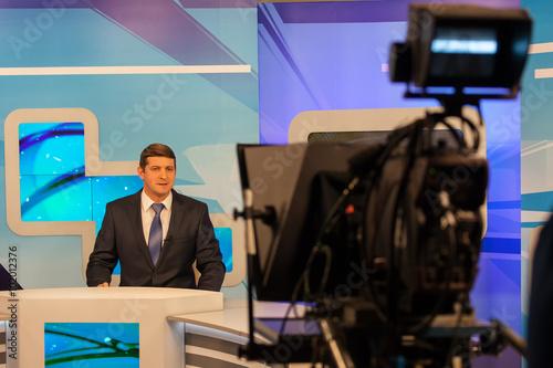 Fototapeta tv studio camera recording male reporter or anchorman. Live broadcasting obraz na płótnie