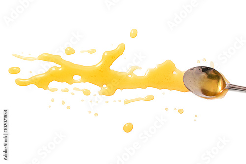 Fotografering  splashes and spilled honey with a spoon