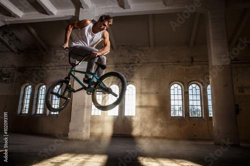 A man jumps with bmx. Wallpaper Mural