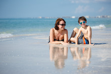 Mother And Son On Tropical Beach In Florida