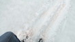 Climber slipping on the snowy glacier while descenting from the mountain pass, pov