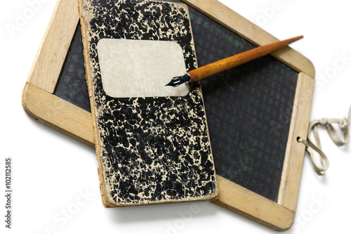 Fotografering An old slate, a penholder and exercise book