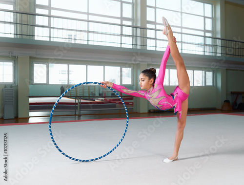 Recess Fitting Gymnastics girl in gymnastic dress doing exercise with hoop