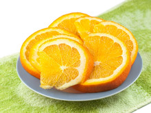 Freshly Sliced Oranges On Glass Plate.  Macro With Shallow Dof.