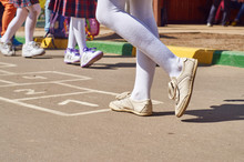 Children Playing Hopscotch At School Yard After The Lessons