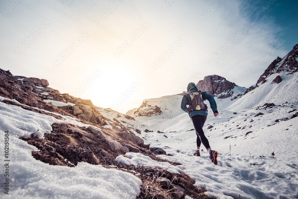 Fototapety, obrazy: Man running on the snow on a mountain