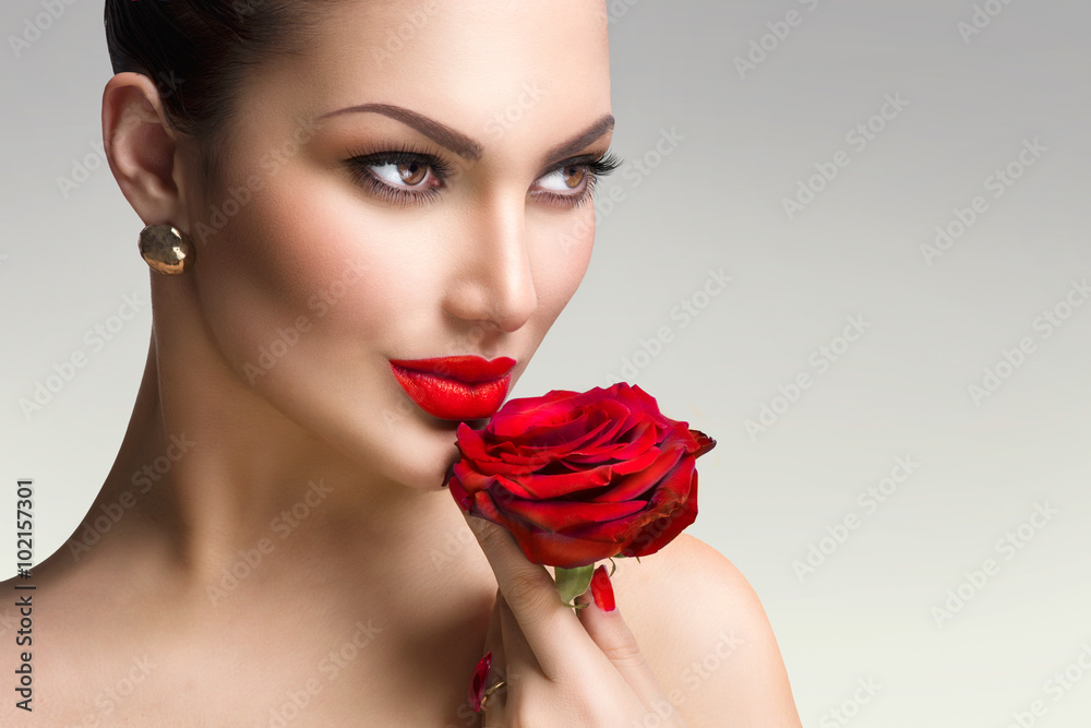 Valokuva  Fashion model girl with red rose in her hand