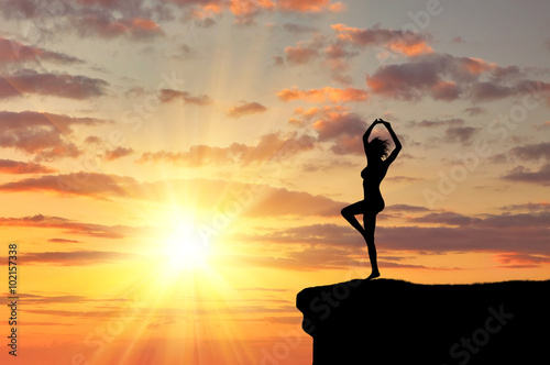 Valokuva  Silhouette of a girl practicing yoga