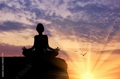 Silhouette of a girl practicing yoga Poster