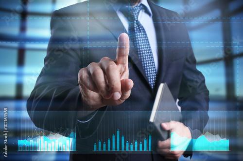 Fototapeta businessman using modern computer, pressing button on virtual screen. business strategy as concept obraz na płótnie