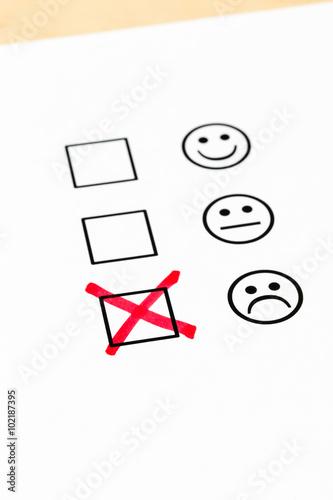 Fotografía  Customer satisfaction survey checkbox with poor symbol tick