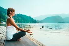 Meditation. Young Woman Meditating By The Lake.