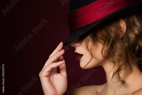 Fotografia, Obraz Portrait of young pretty woman with dark red lips wearing black