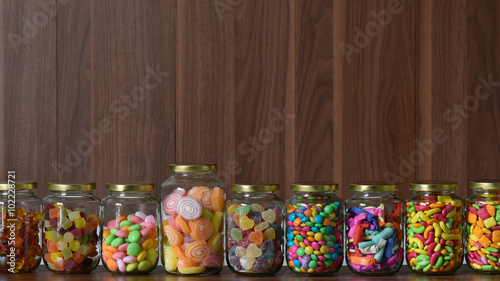 Poster Confiserie Various colorful sugary candy in a class jar
