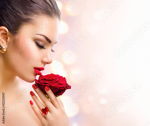 Poster - Fashion model girl face portrait with red rose in her hand