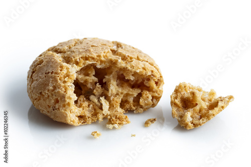 Poster Macarons Detail of one broken Italian amaretti biscuit isolated on white