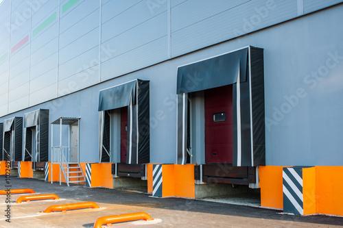 Staande foto Industrial geb. Cargo doors at big industrial warehouse building