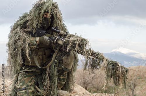Obraz na plátně Ghillie suit sniper camouflage enemy