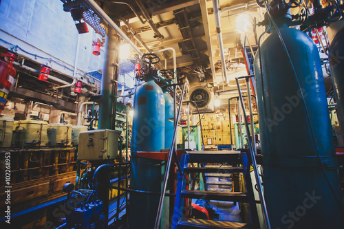Photo  Engine Room on a cargo boat ship interior, ship's engine heavy Machinery Space -