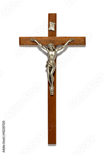 Fotomural Plain wooden crucifix with silver figure of Christ