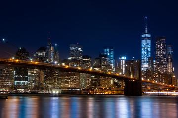 Fototapeta na wymiar Manhattan and the Brooklyn Bridge. Evening