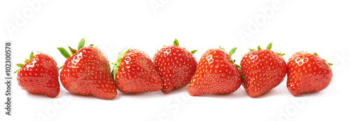 Poster Fresh vegetables Line of red strawberries isolated