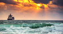 Cargo Ship With Containers In Sunrise Light