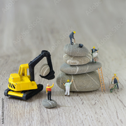 Fotografie, Obraz  Construction site with miniature workers