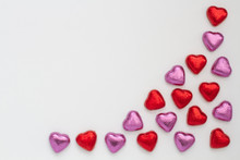 Chocolate Valentine Hearts On An Isolated White Background. Candy Hearts Arranged To Frame A White Background.