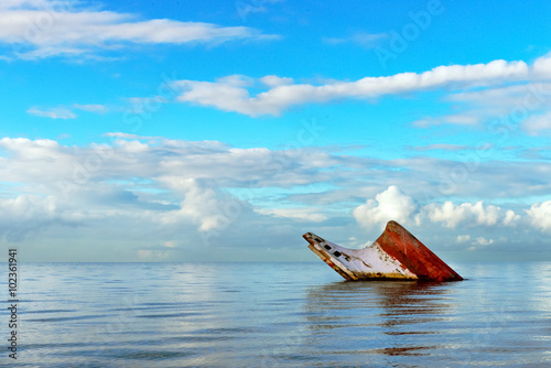 Fotobehang Schipbreuk Ship wreck rusty landscape sinking into the sea Trinidad and Tobago