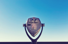 Coin-operated Viewer Against The Blue Sky