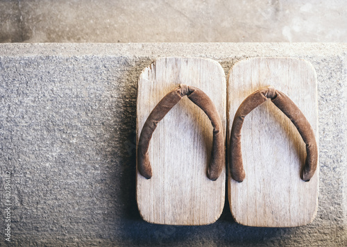 Tuinposter Japan Japan Traditional Footwear Zori on floor Top view