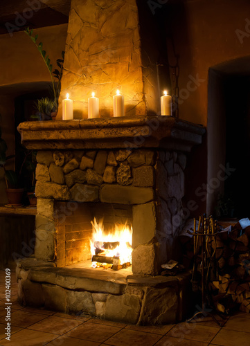 Chimney, candles and woodpile. Classic interior. Chimney place. Vintage  style