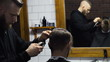 Barber cuts the hair of the client with clipper slow motion