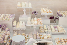 Delicious & Tasty White Decorated Cupcakes At Wedding Reception