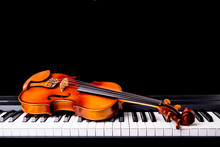 Violin On The Piano On A Black...