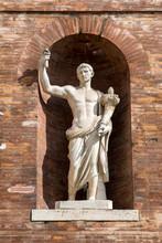 Ancient Roman Statue In Brick Wall Alcove