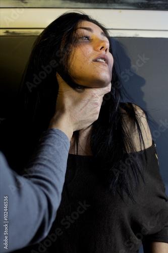 Fotografie, Obraz  woman being strangled by man on street violence on women