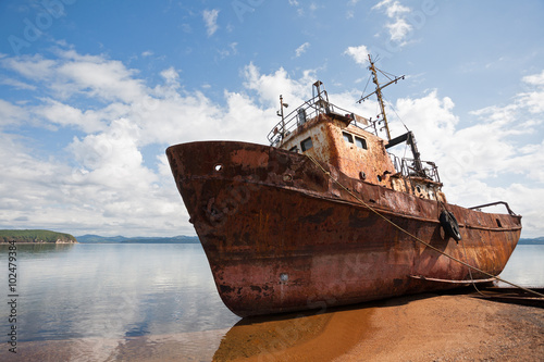 Deurstickers Schip Old fishing vessel on the sea coast