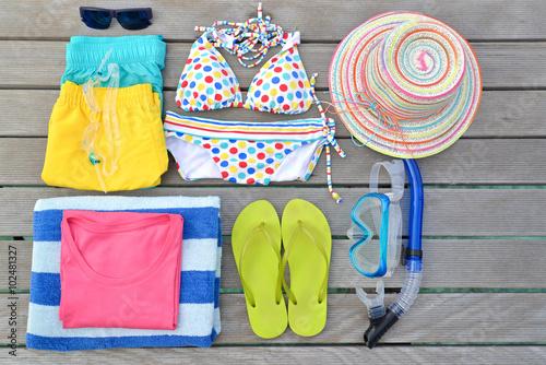 Fotografie, Obraz  Beachwear from top view with sunglasses, goggles, bikini, sandal, short, mask an